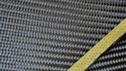 Black carbon fiber composite material background