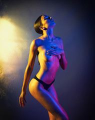 Sexy model with colored lights effect