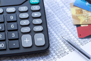 Balancing the Accounts, calculator, credit card and pen