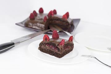 Yummy Healthy Chocolate and Rasberry Cake on white background