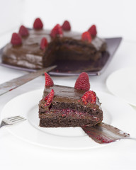 Yummy Healthy Chocolate and Rasberry Cake on white background