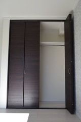 Inside the house, storage of the room, a folding door type closet door