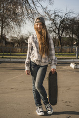 girl with skateboard on street