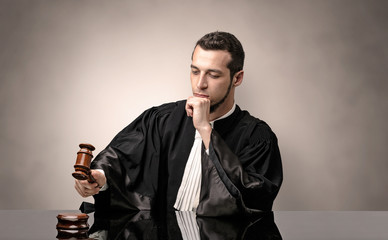 Oldscool young judge in gown