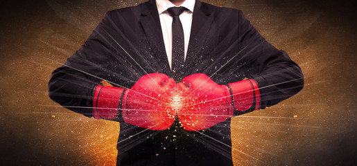 Forceful businessman boxing