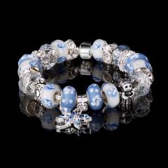 jewelry bracelet female glass crystal elements black background beautiful elegant multicolored handwork chain reflection