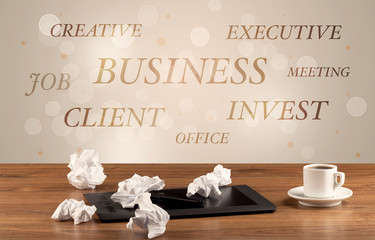 Business office desk with writing on wall