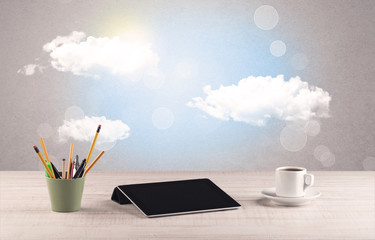 Bright sky with clouds and office desk