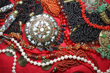 Background-east  jewelry with magnificent coral necklace and pearls