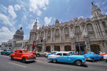 Colorful classic cars in front of the Capitolio in Havana that is capital city of Cuba.