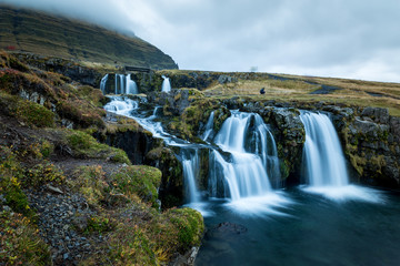 Waterfall and beautiful view at the kirkjufell mountain in iceland europe