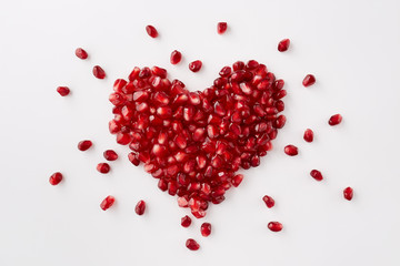 Pomegranate seeds in a shape of a heart