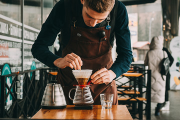 Fototapeta Barista making coffee in coffeeshop obraz