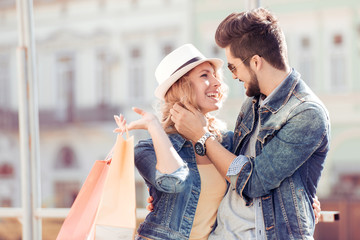 Young couple holding a shopping bags in the city.