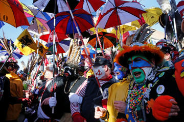 """People wear local carnival costumes during the parade of """"Carnaval de Dunkerque"""" in Dunkirk"""