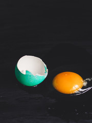 Easter eggs on a dark background (colored eggs - paint)