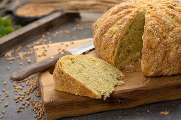 Homemade baked round bread with corn and wheat
