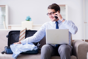 Businessman preparing packing for business trip