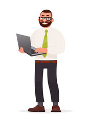 Programmer. A bearded man with glasses is holding a laptop in his hands. Software developer