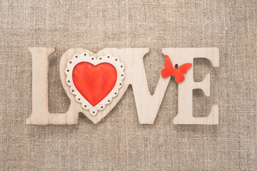Love sign on a burlap background