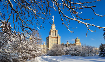 Wide angle view of sunny snow campus of Moscow University