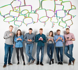 Group of boys and girls connected with their smartphones. Concept of internet and social network