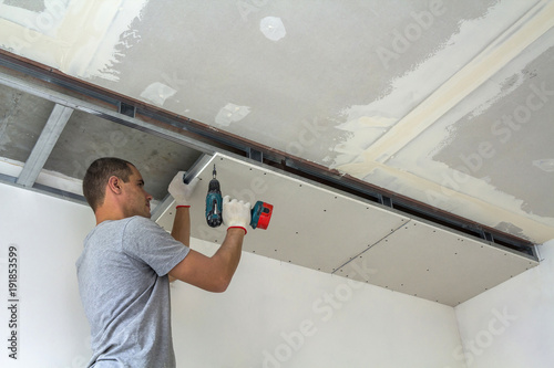 Construction Worker Assemble A Suspended Ceiling With