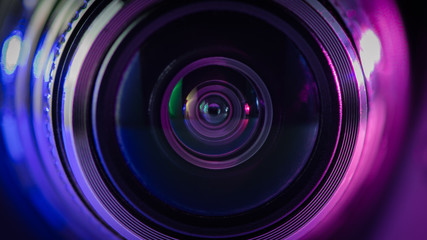 Camera lens and multi-colored backlight blue and purple.