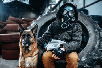 Stalker in gas mask and dog, post-apocalypse