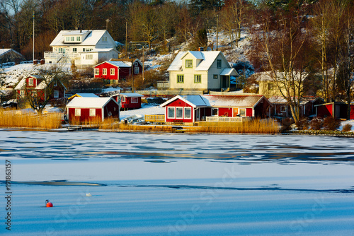 Small Seaside Village In Winter Landscape Bay Is Frozen And The Morning Sunshine Barely