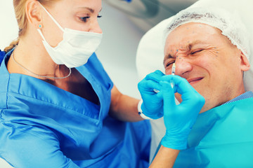Female specialist is doing injection to client for anti-aging