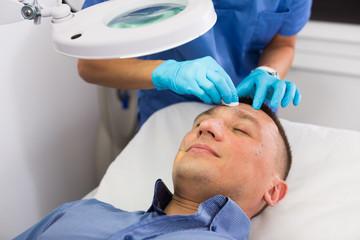 Woman doctor is examining patient before the procedure