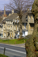 Quaint Cotswold cottages in early spring sunshine on The Hill, Burford, Oxfordshire, UK