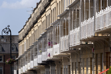 Ornate ironwork on the balconies that decorate the terraces of historic houses in the Clifton area of the City of Bristol, UK