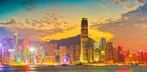 Victoria Harbor and Hong Kong skyline at sunset.