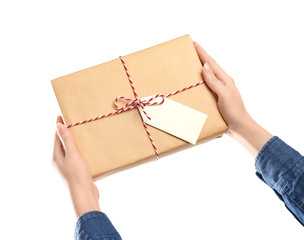 Woman with parcel gift box on white background