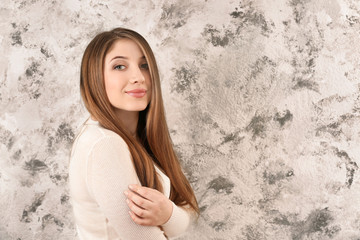 Portrait of beautiful smiling woman on grunge background