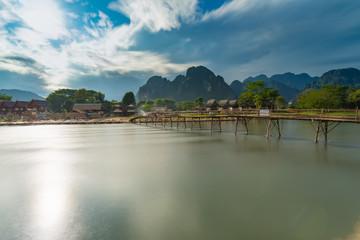 Long exposure Wood bridge on naw song river in Vang vieng, Laos.