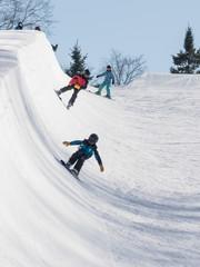 People are enjoying half-pipe skiing
