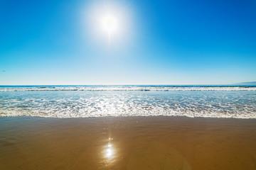 Sun shining over Santa Monica beach on a clear day Wall mural