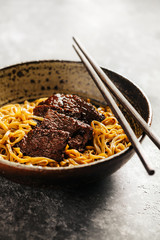Soba noodles with beef and chopsticks. Buckwheat Noodle.