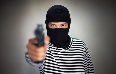 terrorist ware mask and hold pistol, gun, in hand