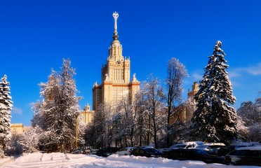 Bright wide angle view of fantastic sunny snow campus of Moscow University in winter