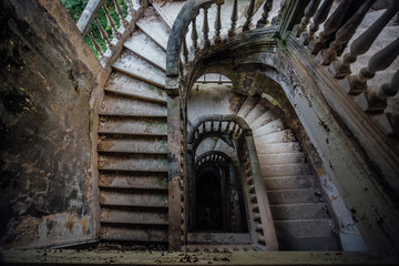 Top view of old vintage decorated staircase in abandoned mansion