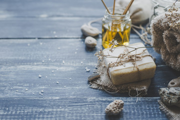 Spa composition. Various products for spa treatments on rustic wooden background, selective focus
