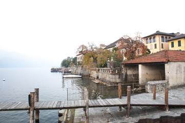 view of the lake with jetty and tenements in winter