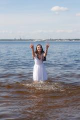 cheerful girl in white dress