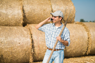 Smiling farmer talking on the phone