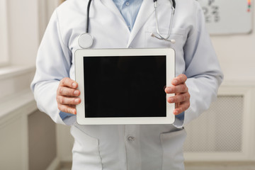 Closeup of doctor holding tablet computer with a blank screen