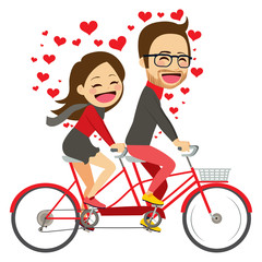 Cute young couple on Valentine day riding on tandem bicycle celebrating love together